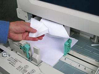 Pull out the paper tray where the paper jam occurred
