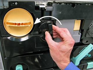 Turn drum lock lever to left.