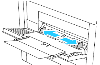 Move the width guides to the edges of the tray