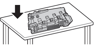 Place the waste cartridge on a flat surface