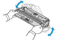 Slowly shake the new cartridge five or six times to distribute the toner evenly inside the cartridge