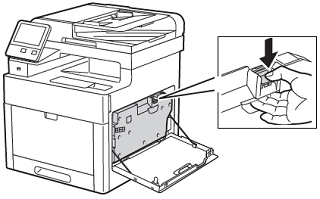 Press down on the waste cartridge release latch